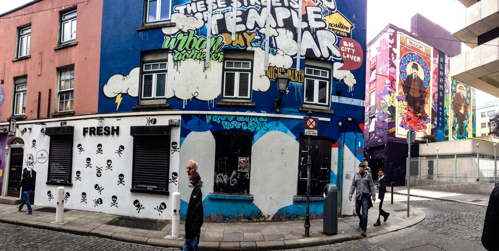 Murals in Temple Bar. Don't be alarmed by the semi-decapitated people, it's just what iPhone panoramas do.