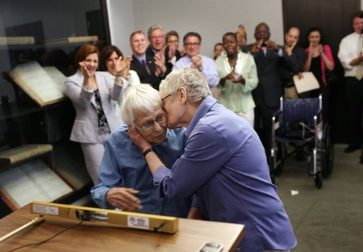Phyllis Siegel, 76, right, kisses her wife Connie Kopelov, 84, after exchanging vows … NEW YORK (AP) — Buoyant gay couples cheered by supporters began marrying Sunday across New York on the landmark day it became the sixth and largest state to recognize same-sex weddings.