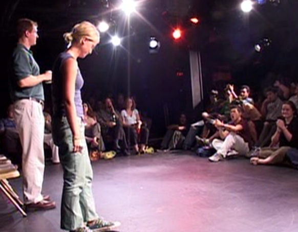 improvdoc: Amy Poehler and Ian Roberts at the Upright Citizens Brigade Theatre during the Del Close Marathon, circa 2003.  Still from On The Cusp, Off The Cuff.  Original footage courtesy of Petra Boden.