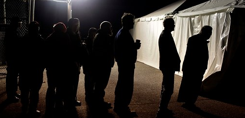 Under generator-powered lights, New Yorkers waited to vote in Staten Island's Midland Beach section in an unheated voting tent. #democracy via New York Times