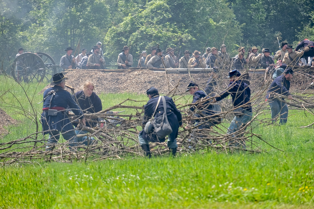 Clearing the brush field obstacle so that the Union infantry can attack the Rebel position behind the earthworks.