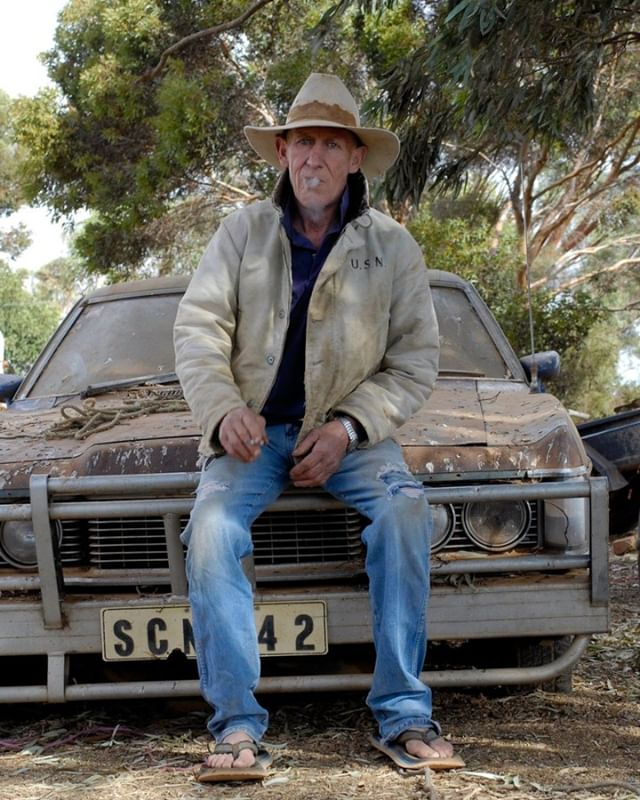 When I first met Tom Bruce he was 61 years old. That is now ten years ago. Tom was a cowboy and sheep shearer in the friendly little town of Peterborough. Like many #Australians he fought in the #Vietnam war. After that he lost his way and became hooked on #alcohol for a long time. 'I wrecked quite a few cars and was living a reckless life.' When he was 40 he moved to the state of #Wyoming, #USA, where he worked as a cowboy breaking racehorses and competing in rodeos, 'just looking for adventure'. He was cast as a #Marlboro man there, acting in various commercials for the famous cigarette brand. Tom returned to #Australia in 2002 and now lives with his girlfriend Carol and her son.  Vietnam determined the course of his life, Tom figures: 'I guess if I had never been to Nam I would now be farming on Kangaroo Island, with a wife and kids. Still, I don't regret anything I did in my life. I've had good times and bad times, but in the end it always worked out to something positive. I lived a good life and did a lot of dangerous things - that was just part of it.' Drinking is not a problem anymore. 'I can now use alcohol as a social thing and don't have to go that far anymore. But Vietnam is still in my body. Not a single day goes by that I don't think about it. I had pretty intense nightmares for many years, and I still do 40 years after, but they're not as bad anymore now.' Tom looks like a tough cowboy, and he definitely is, but there is something very gentle about this man. He cares for all sorts of animals, has five or six kangaroos hopping around his property, not to mention his enormous longhorn bull he named 'Vegemite' that nobody in Peterborough dares to come close to. Tom caresses him as if he were a nice little kitten. Quite a character this man.  #australia #outback #cowboy #adelaide #desert #vietnamwar #vietnamveteran