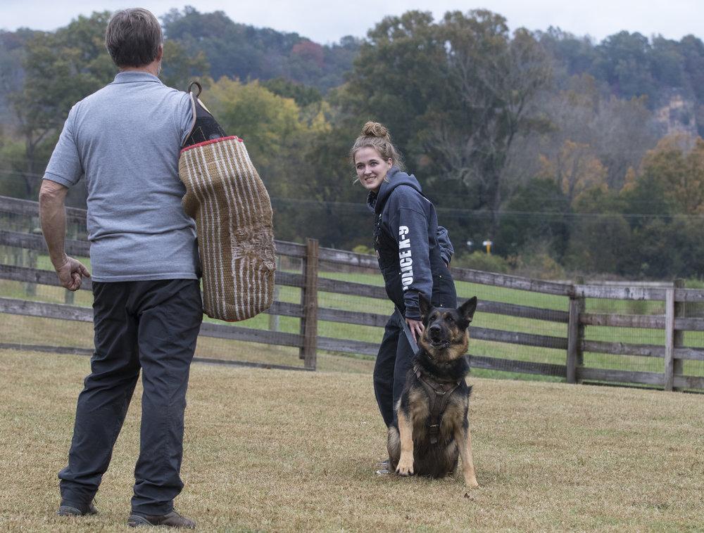 Megan practicing her handler skills with Luna