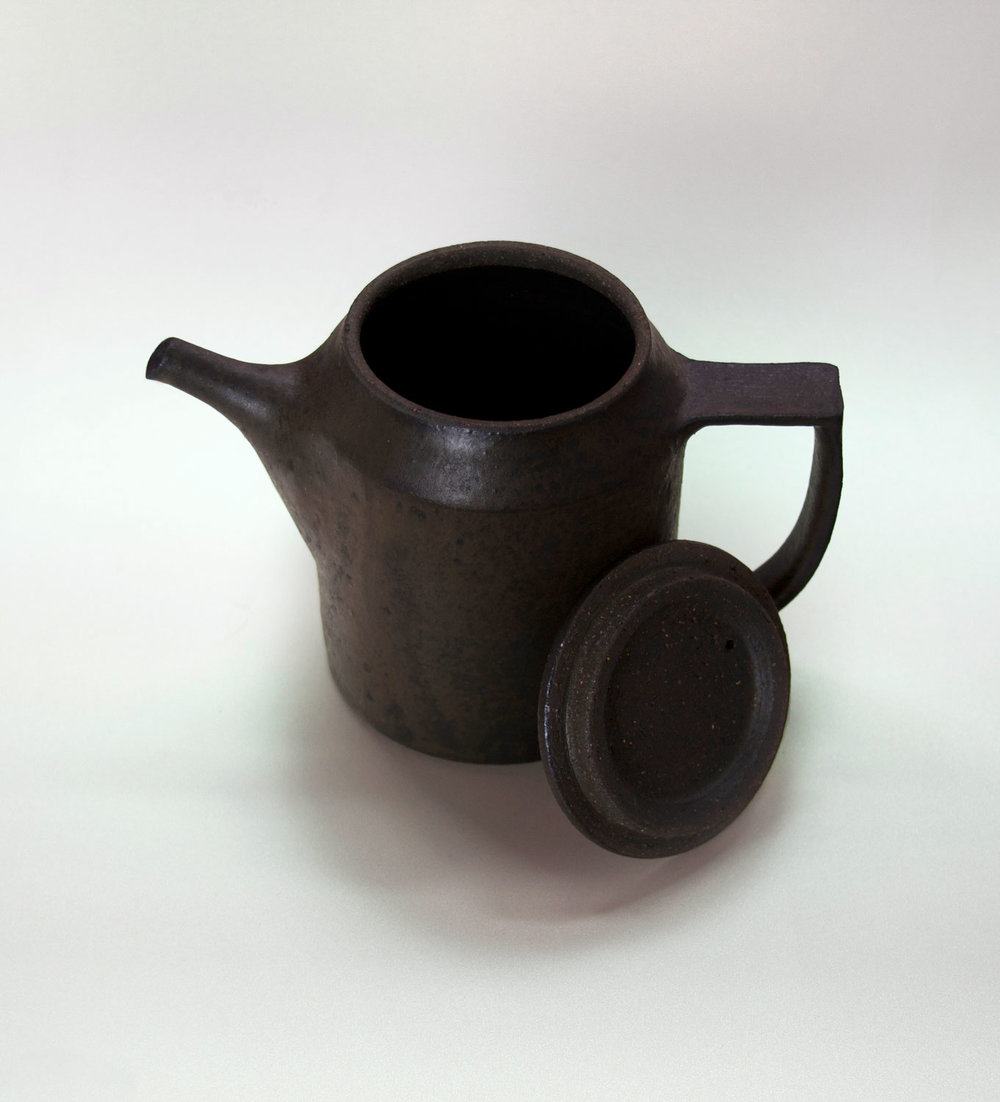 The frosting on this handcrafted coffee pot makes camp gets an iron like feel.  See it on japan-suite   .