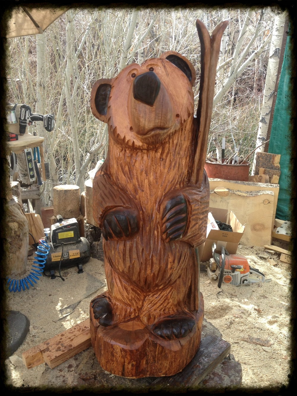 3 1/2 foot bear holding skis