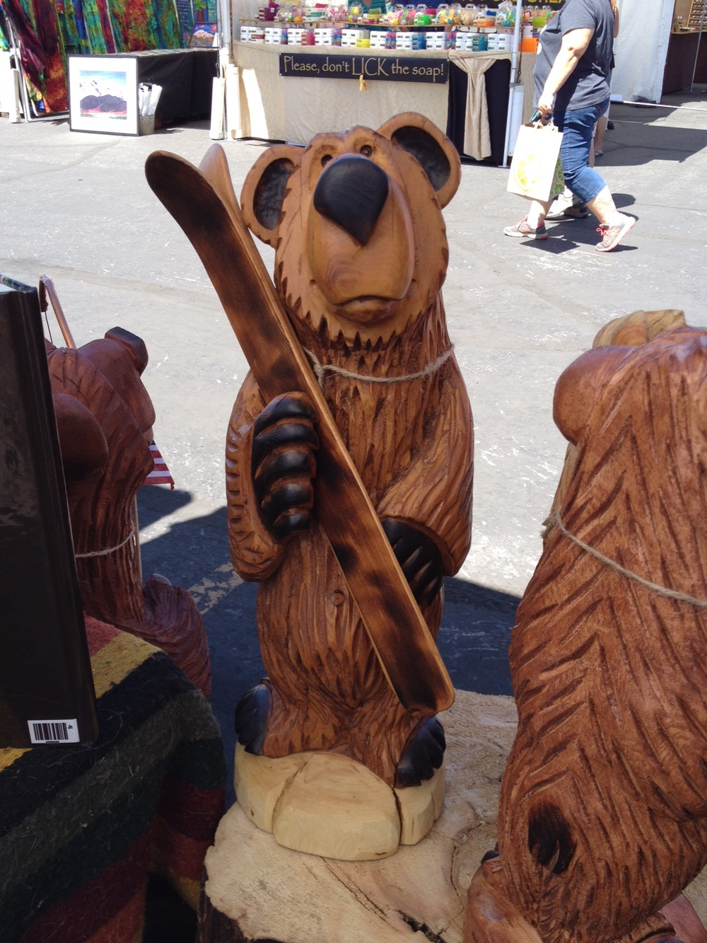 Bear holding skis