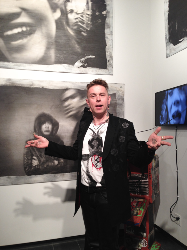 Clay Patrick McBride standing in front of his amazing work
