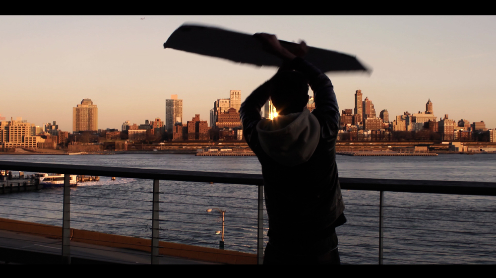 NYC sign-spinner. Still from the film.