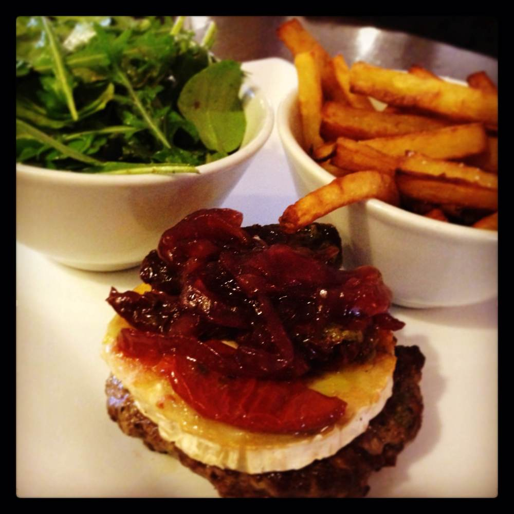 Isle Lose it  Old School Burger , homemade 100% beef burger (no bread), dressed with grilled goats cheese, sun dried tomato, caramelized onions, parsnip chips and watercress and rocket salad.