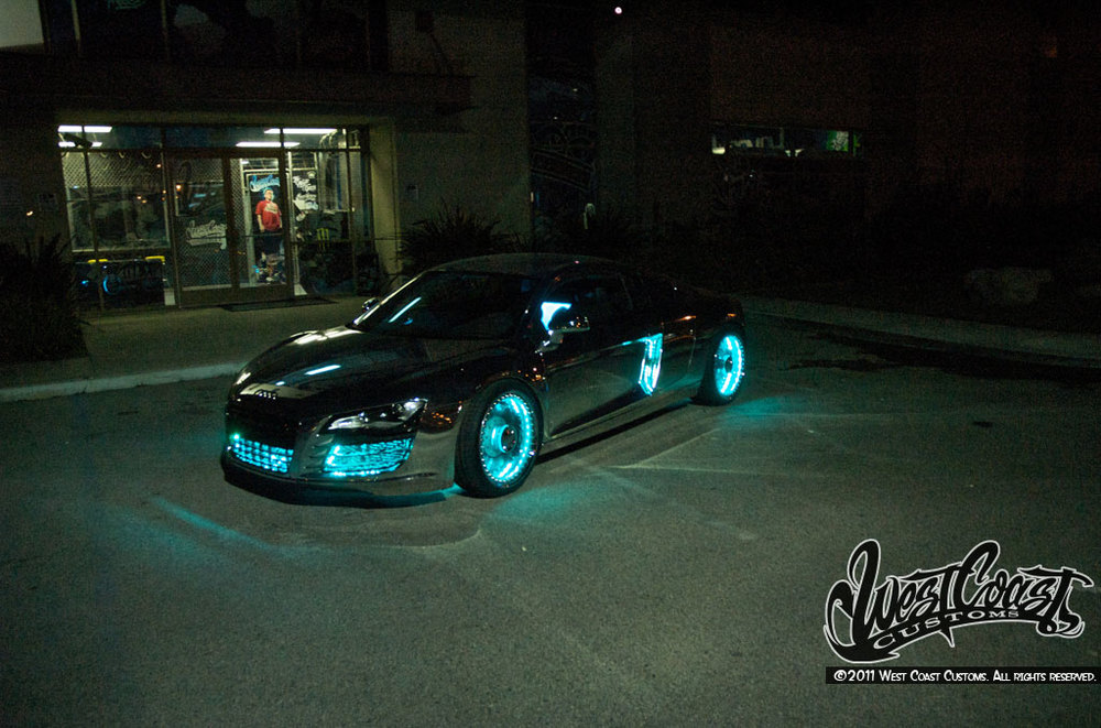 This custom made tron audi r8 car is pretty freakin awesome check out the pictures of the tron audi r8 below and tell us what you think publicscrutiny Choice Image