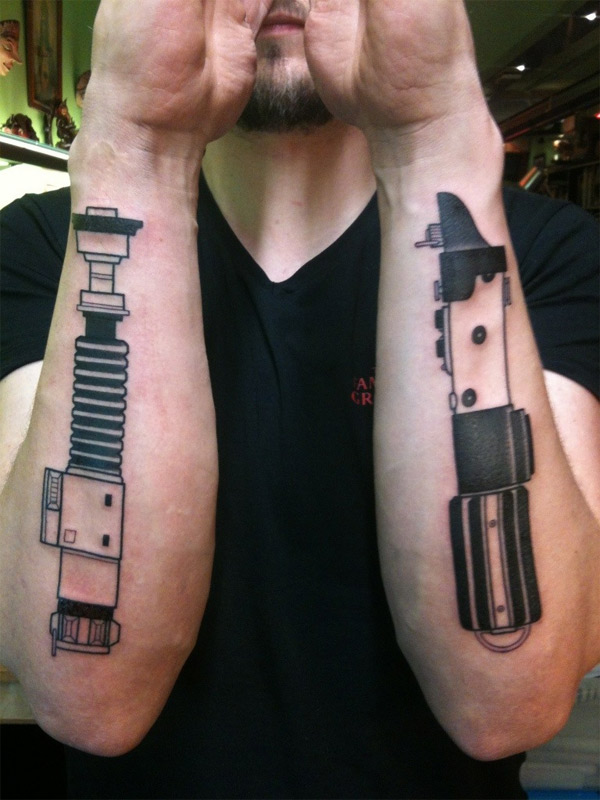 Dueling lightsaber arm tattoos geektyrant for Luke skywalker tattoo