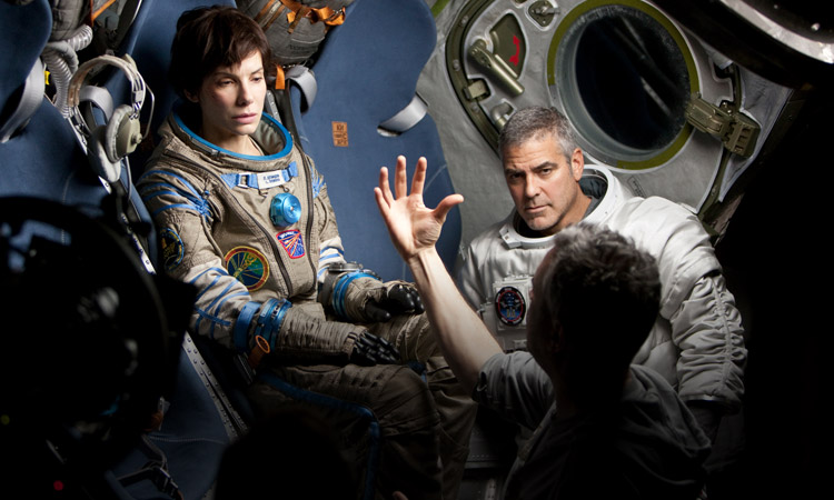 """We Can Shoot It In One Year And We're Out"": 5 Things Learned About Alfonso Cuaron's 'Gravity'"