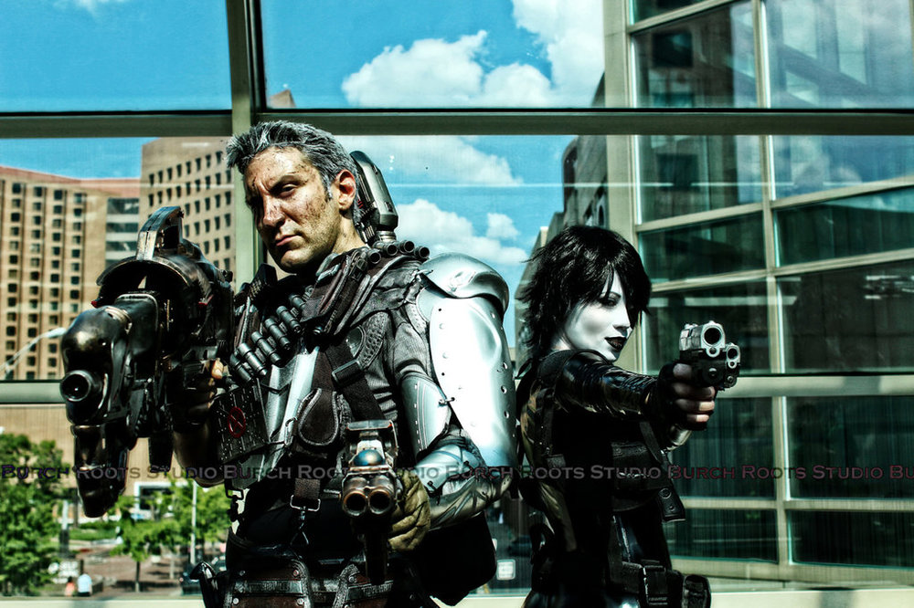 Evelynne Bell is Domino and James T Wulfgar is Cable | Photo by: BurchRootsStudio