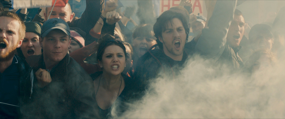 Scarlet Witch and Quicksilver in a crowd of protesters.