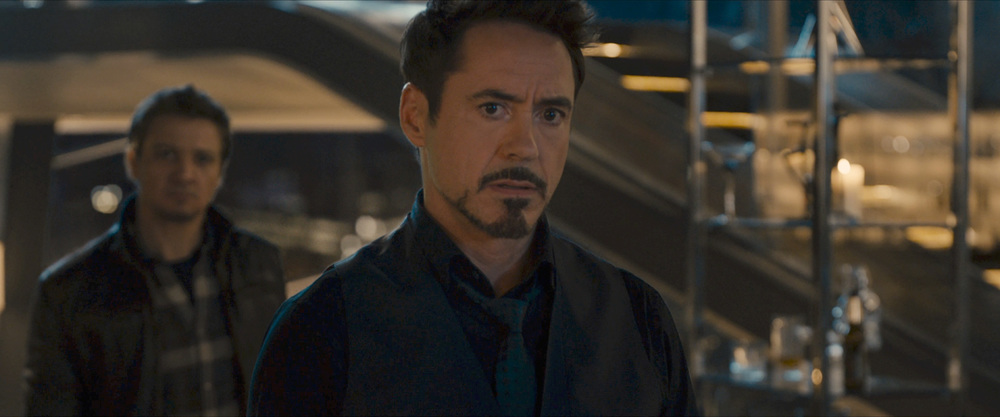 Tony Stark andClint Barton analyzing the party crasher.