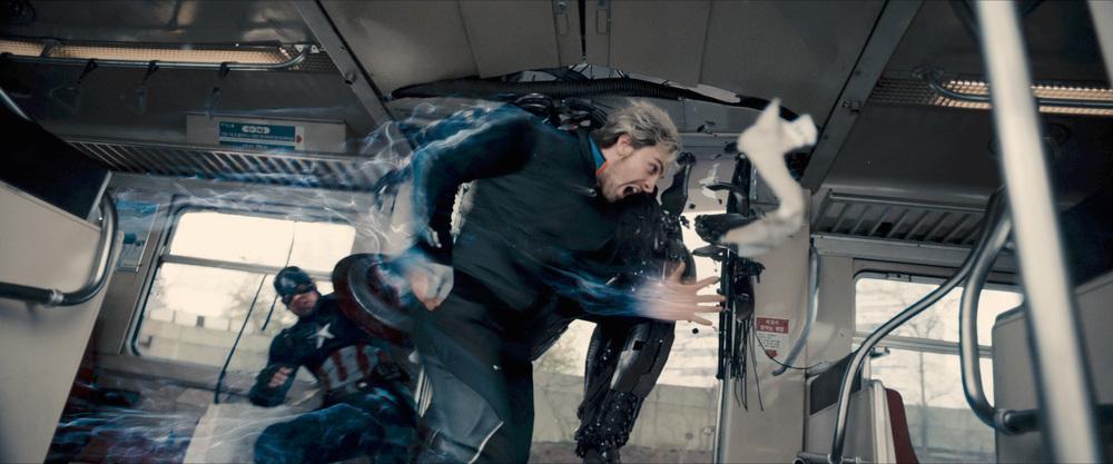 Looks like Quicksilver is saving Captain America.