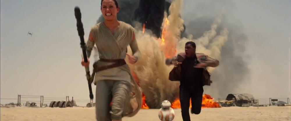 Rey, BB-8, and Finn under attackfrom a Tie Fighter