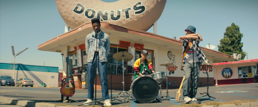 We've got a new trailer to share with you for a film called Dope, which was one of the most buzzed about movies at Sundance this year. I didn't get a chance to see it myself, buy you can read Eli's glowing review for it here, in which he sates:  The young leads — Shameik Moore as Malcolm, Tony Revolori (The Grand Budapest Hotel) as Jib, and Kiersey Clemons (Eye Candy) as Diggy — have incredible chemistry, and that magic shines brighter as their characters navigate through their increasingly bizarre situation and are forced to get rid of the drugs, one way or another.  The movie looks absolutely fantastic, and I'm very much looking forward to finally seeing it for myself. I really wish I wouldn't have missed the opportunity at Sundance, but thankfully it's going to get a decent sized theatrical release. Here's the synopsis:  Malcolm is a high school geek with a high-top fade, carefully navigating life in The Bottoms, one of the toughest neighborhoods in Inglewood, California. He and his fellow outcasts share a voracious appreciation for all things '90s hip-hop, opting to sport Cross-Colours and Z. Cavariccis at the risk of being clowned at school. He dreams of attending Harvard, but first he has to make it home every day. When a drug dealer takes a shine to Malcolm and invites him to his birthday party, Malcolm's crew is swirled into a hilarious blender of offbeat characters and bad choices where redemption can only be found in Bitcoin. The film was written and directed by Rick Famuyiwa (Brown Sugar, Our Family Wedding), and it landed itself a summer release date of June 19th.