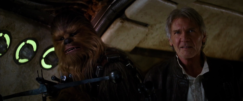 """""""Chewie, we're home"""" and very clearly on theMillennium Falcon. Whats interesting that that they have their weapons raised."""