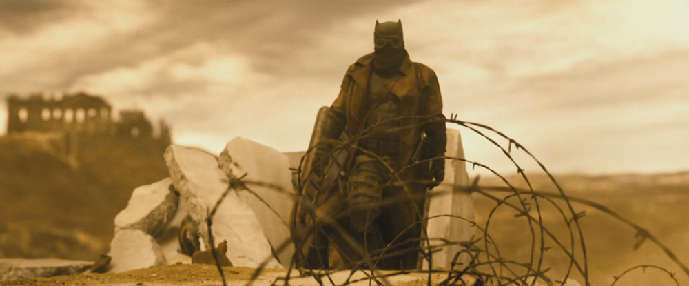 batman-v-superman-close-up-shot-of-batmans-desert-battle-uniform-and-new-banner1