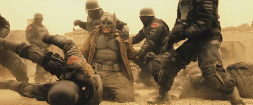 batman-v-superman-close-up-shot-of-batmans-desert-battle-uniform-and-new-banner3