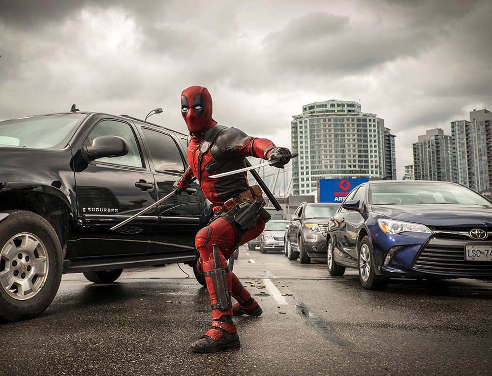 deadpool-busts-out-his-swords-in-new-movie-photos