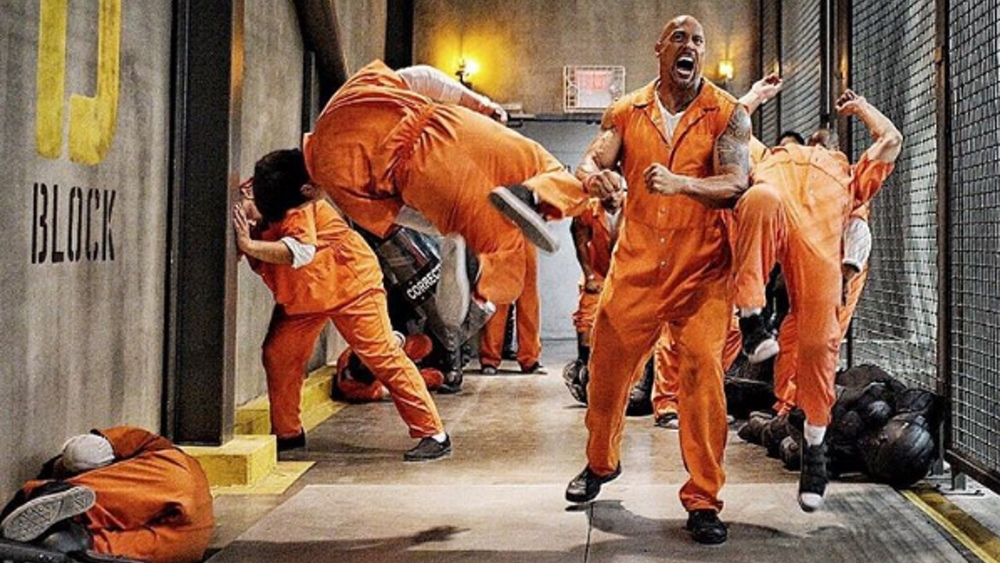 the rock jail_Dwayne Johnson Looks Like an Insane Beast in FAST 8 Prison Riot Photos — GeekTyrant