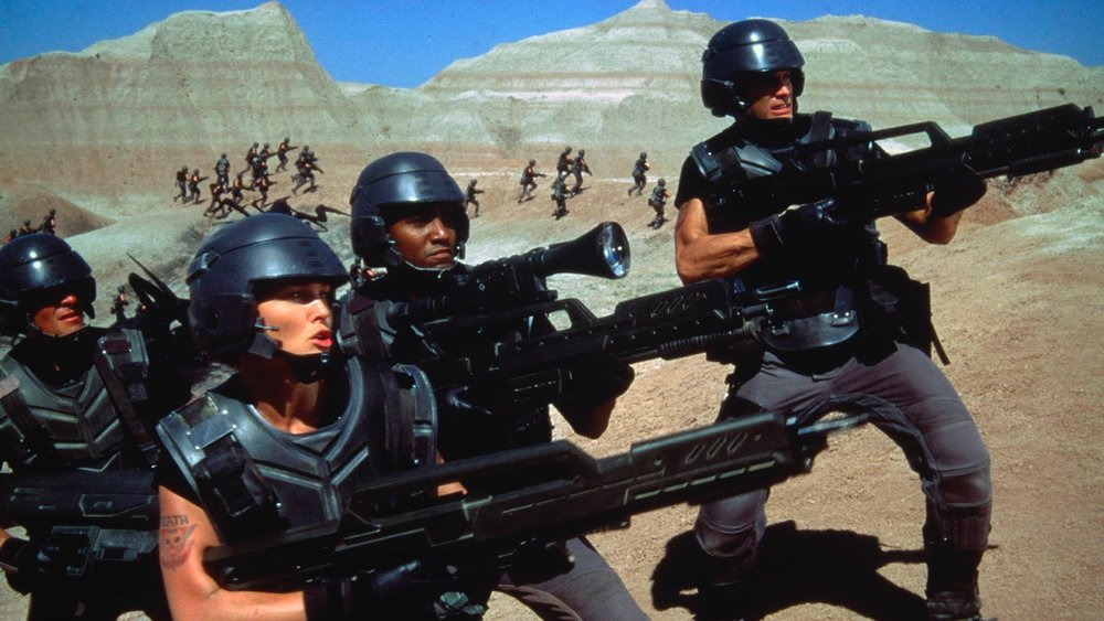 a review of the movie starship troopers by paul verhoeven While his past decade of films saw verhoeven acting as a european outsider  satirizing america, starship troopers' position as a direct allegory.