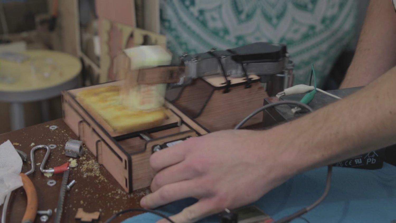 Guy Makes Dangerous Bread Buttering Robot In Hilarious Video