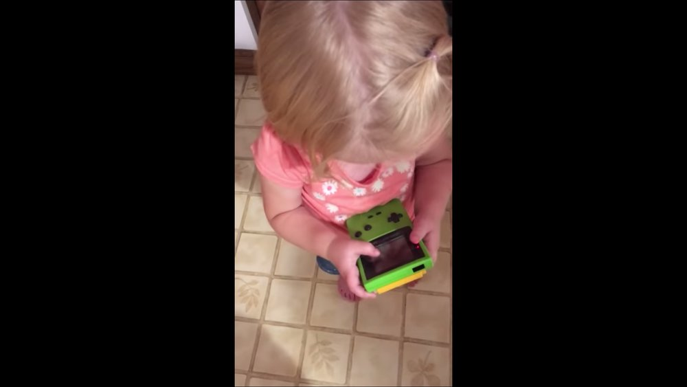 watching-this-toddler-trying-to-play-a-gameboy-will-age-you-social.jpg