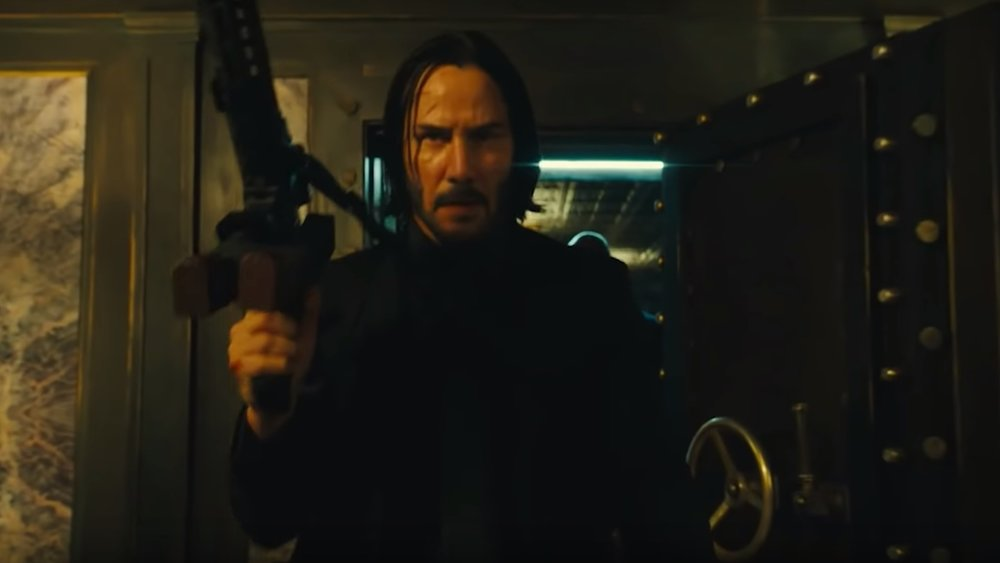 watch-keanu-reeves-and-halle-barrys-intense-weapon-training-for-john-wick-chapter-3-social.jpg
