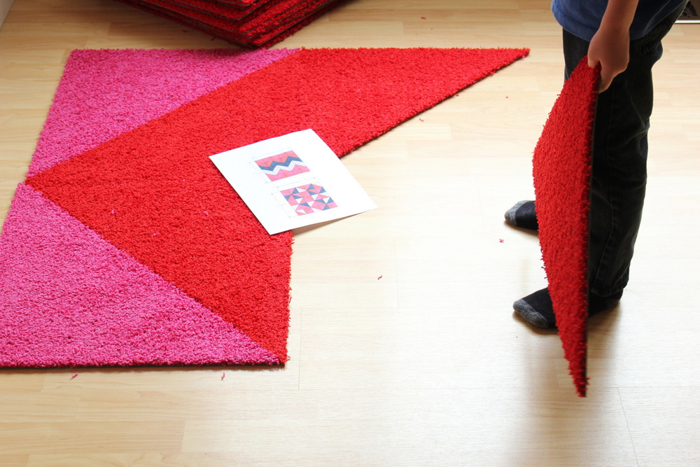 Installing FLOR tiles.JPG