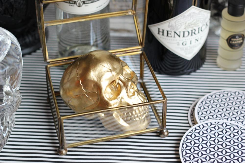 diy gold skull in curio box.JPG