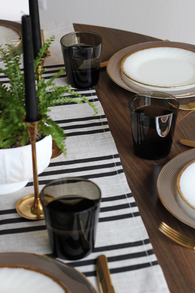 simple black linen and gold table.JPG