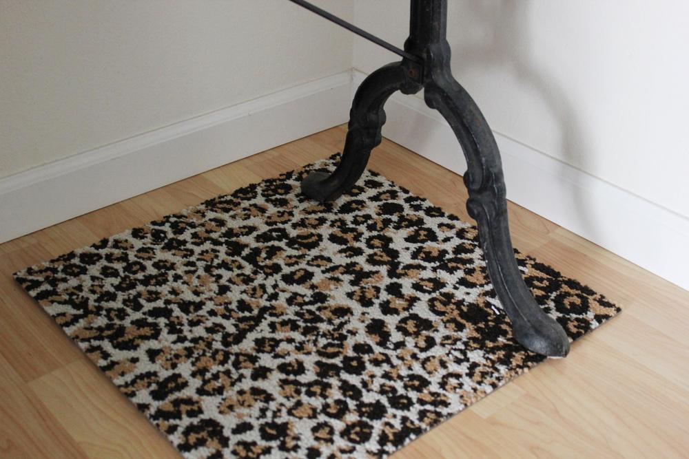 leopard rug installation 1.JPG