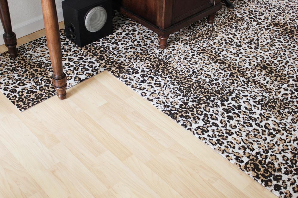 leopard rug installation 3.JPG