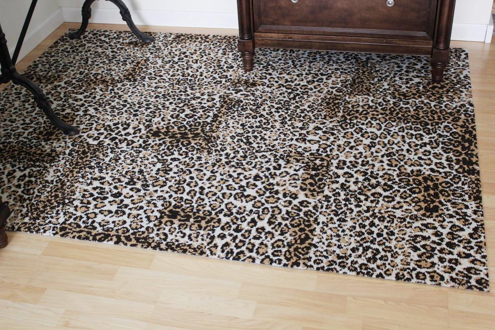 leopard rug installation 2.JPG