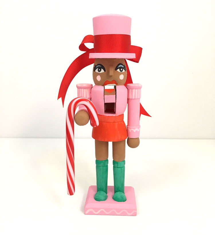 holiday girl nutcracker hand painted, add a fun little modern twist to traditional holiday decorations with a pop of pink.