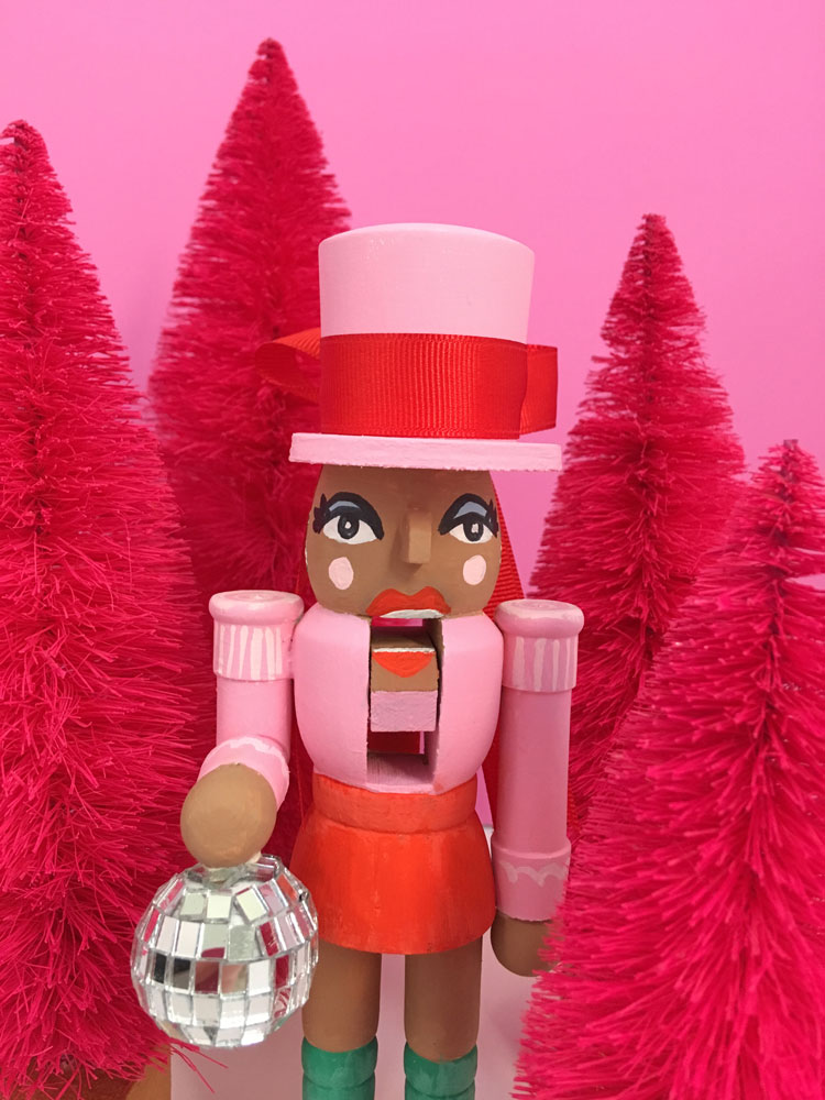 Add a girl nutcracker to your holiday decor in pink.