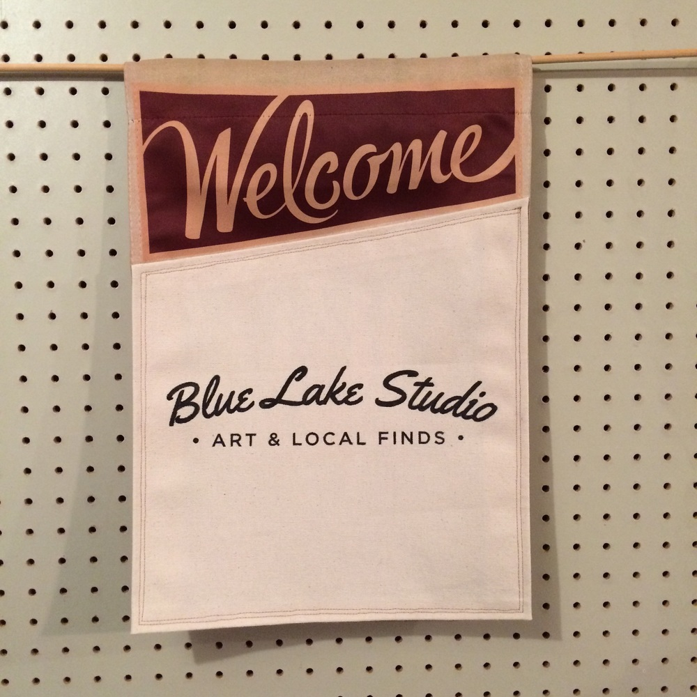 I created the logo for Blue Lake Studio and made some banners to hang outside their business.