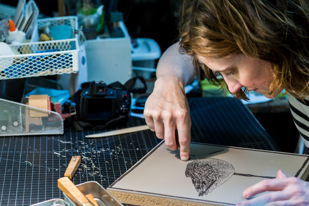 Me working on the linocut of the Marbled Godwit. Photo by Ryan Filgas.