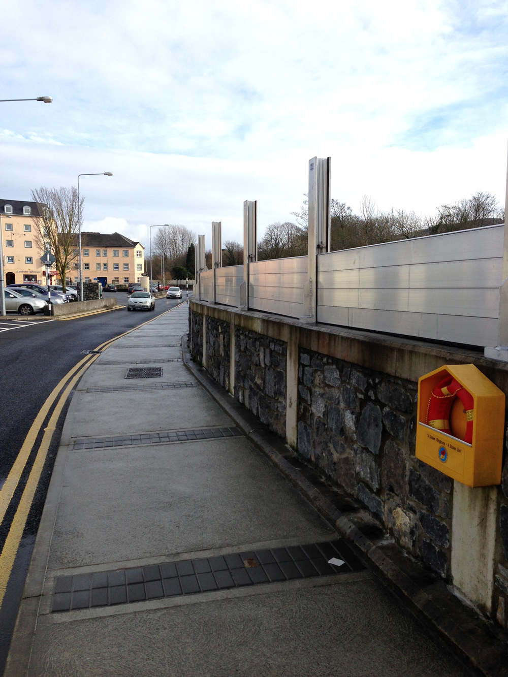 Demountable flood defences partially in place on quay wall along River Suir