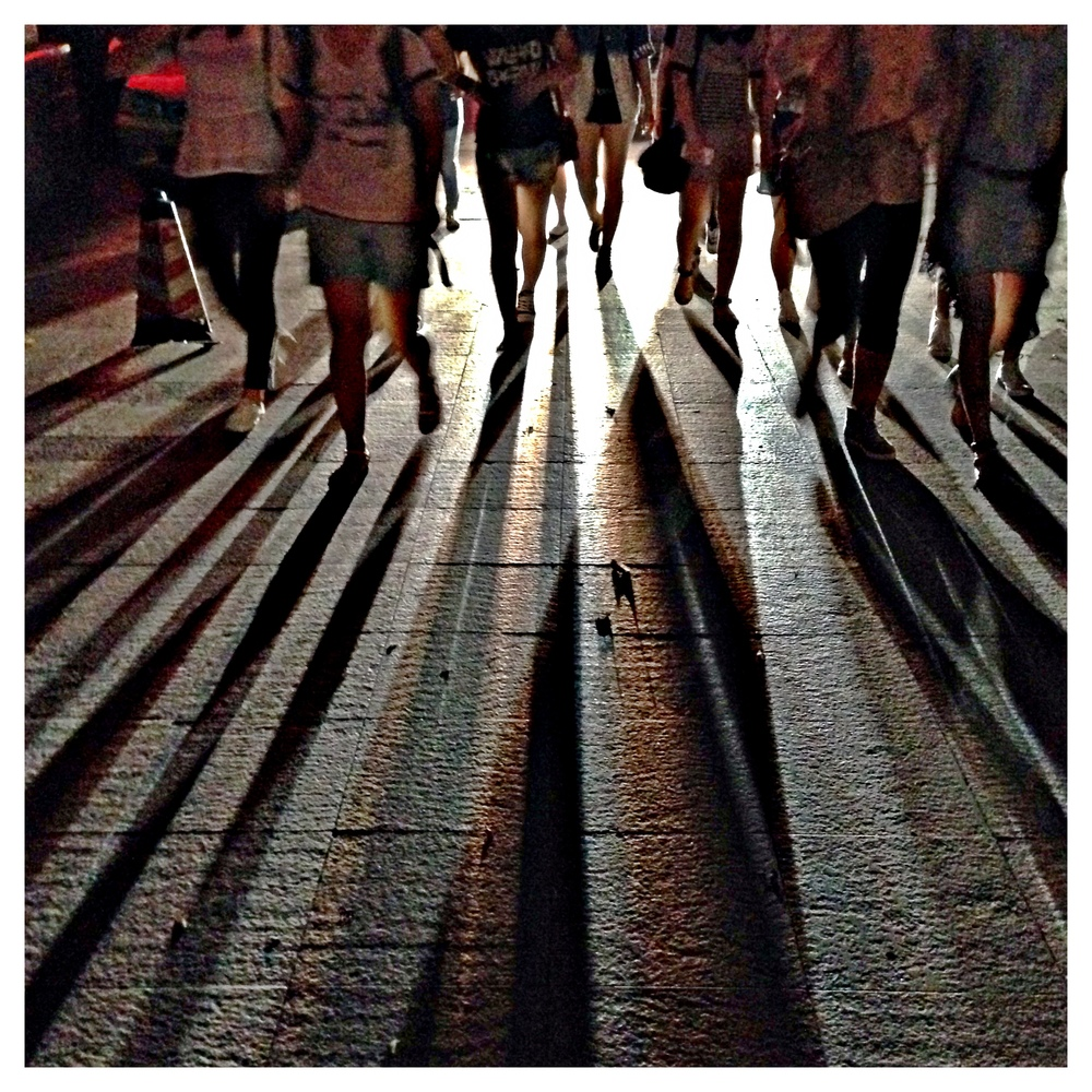 Pedestrians caught in oncoing headlights, Gangding, Guangzhou, May 2014