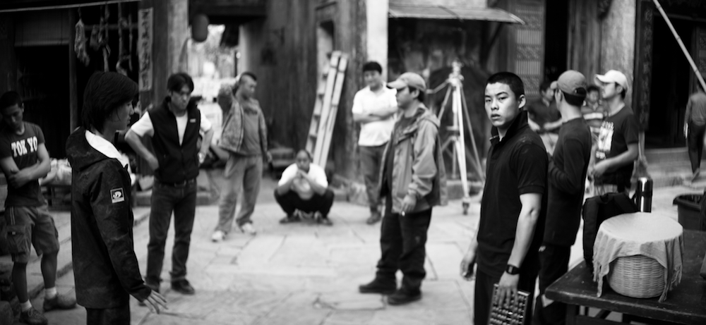 Martial arts director and his men designing a fight sequence on a film set.