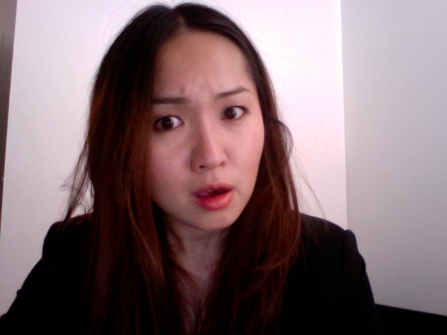 "I have been told that I express a lot through my face, and so here is my facial expression when I get an email that is ""lost in translation.""    I'm wearing Orange Flare, my favorite lipstick color at the moment. it's shiney and sheer and gives a hint of nice color."