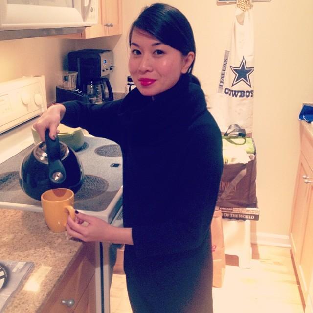 My older sister making tea for me.