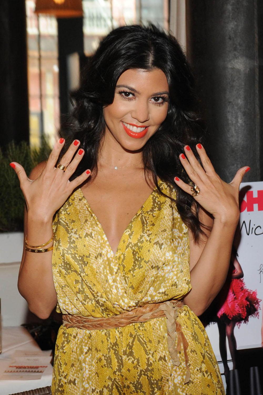 Kourtney-Kardashian-wearing-Nicole-by-OPI-Kardashian-Kolors-Kourt-is-Red-y-for-a-Pedi.jpg