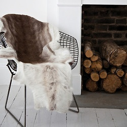 This Bertoia Side Chair instantly become cozier when fur's involved.