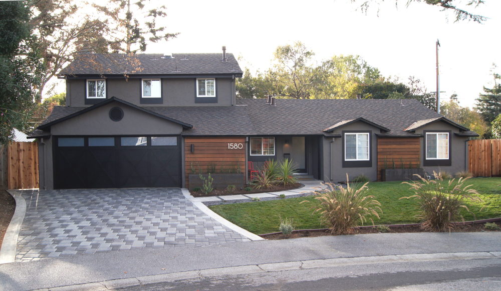 AFTER - TADA!! A little paint, board and battan, new circular garage vent, exaggerated trim additions, shutter and divided light removal, Ipe siding, new door, new lighting, custom planters, and new flowers; the house stands out amongest the neighbors and brings in the rustic modern elements that Heather and Brad love so much. They are very happy, as are we!