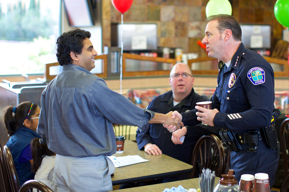 Chief attending HPD's Coffee with a Cop. by Erick Chavez